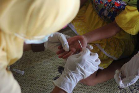 Children hands being swabbed