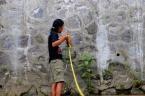 TB. Budiarto measuring the river width - Photograph by Nova Rachmad Basuki