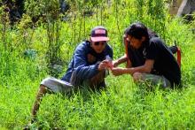 Dholy Husada and TB. Budiarto measuring the water pH - Photograph by Nova Rachmad Basuki